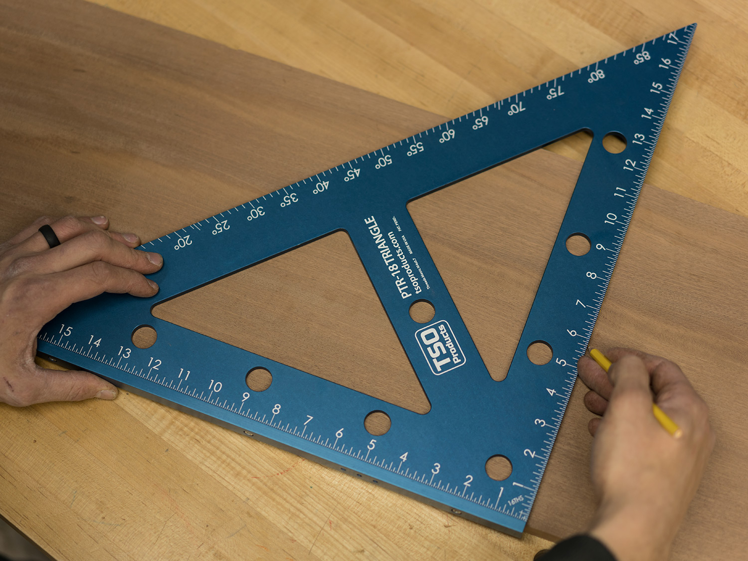 Reference off the edge of your workpiece for dead-square 90 or 45 degree angle marking.